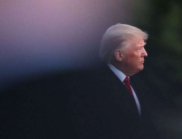 WASHINGTON, DC - DECEMBER 18: U.S. President Donald Trump walks toward Marine One prior to his departure...