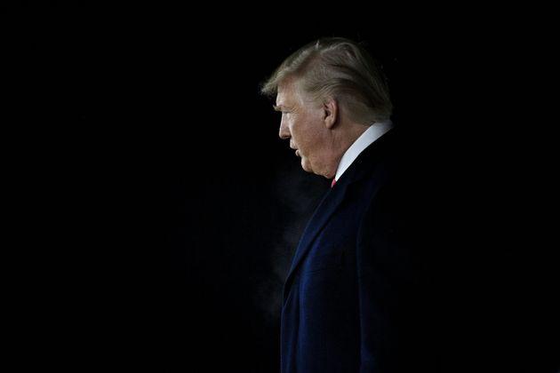 US President Donald Trump arrives at W. K. Kellogg Airport as the US House of Representatives debates...