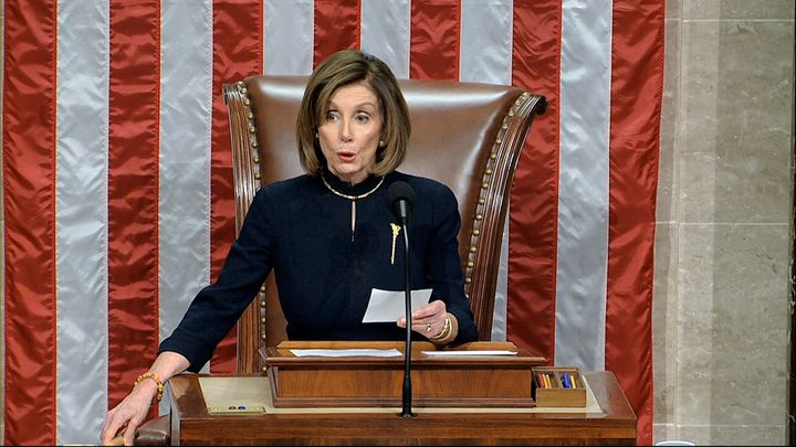 House Speaker Nancy Pelosi of Calif., announces the passage of the first article of impeachment, abuse of power, against President Donald Trump by the House of Representatives at the Capitol in Washington on Wednesday.