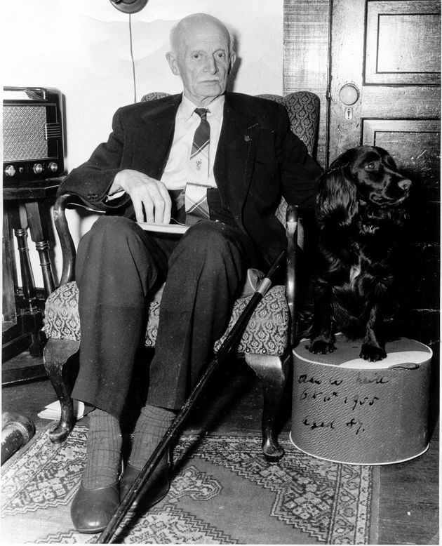 Former federal and provincial politician Alan Webster Neill sits with his dog in a photo from 1955 at...