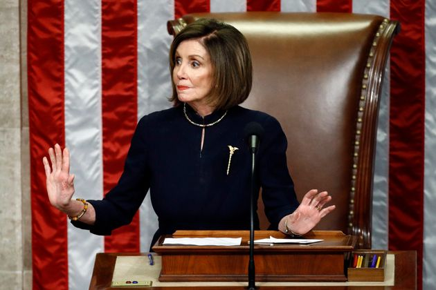 House Speaker Nancy Pelosi of Calif., gestures for Democrats to stop taking during a vote on the articles...