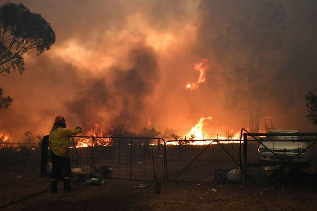 Rural Fire Service (RFS) crews engage in property protection of a number of homes along the Old Hume...