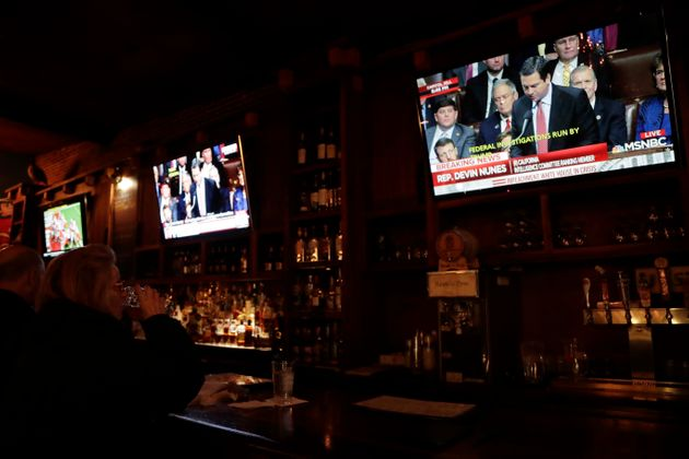 A patron watches a television screen at the Hawk 'n' Dove bar showing Rep. Devin Nunes, R-Calif., as...