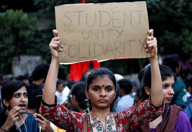 A demonstrator during a protest march to show solidarity with the students of New Delhi's Jamia Millia...