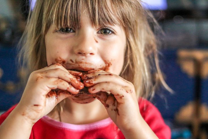 Little girl with a face full of chocolate food