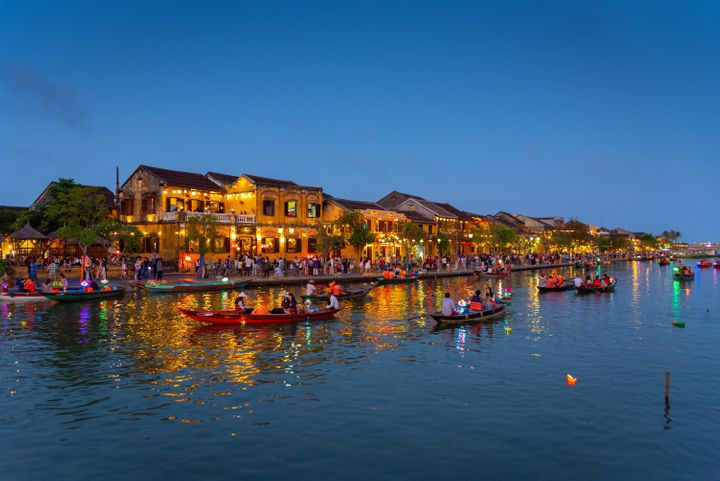 This is a picture of the town of Hoi An located in central Vietnam. An old trading port, it has largely escaped destruction from wars and due to its  preserved architecture and many monuments has been declared a UNESCO World Heritage site. Due to its beauty it is a very touristic destination.