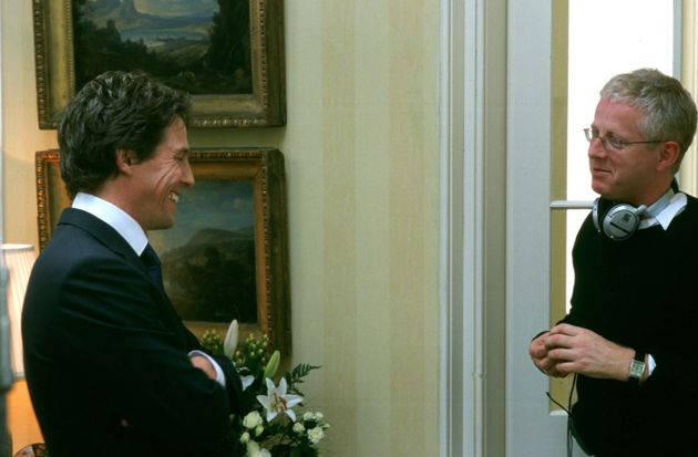 Hugh Grant (left) and Richard Curtis on the Love Actually set in
