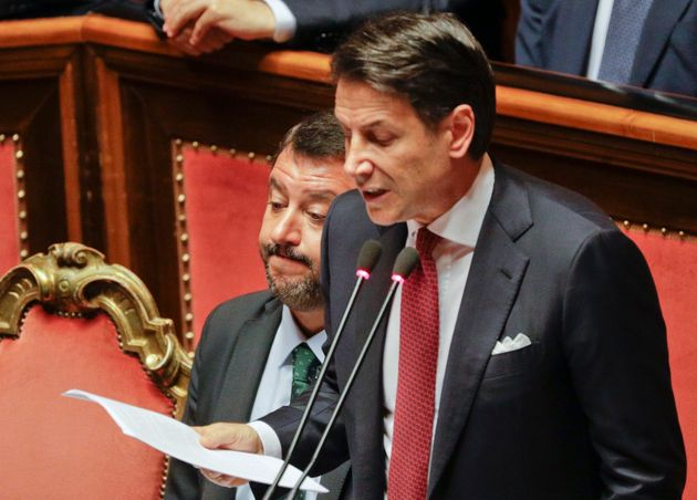 Italian Premier Giuseppe Conte, right, is flanked by Deputy-Premier Matteo Salvini as he addresses the...