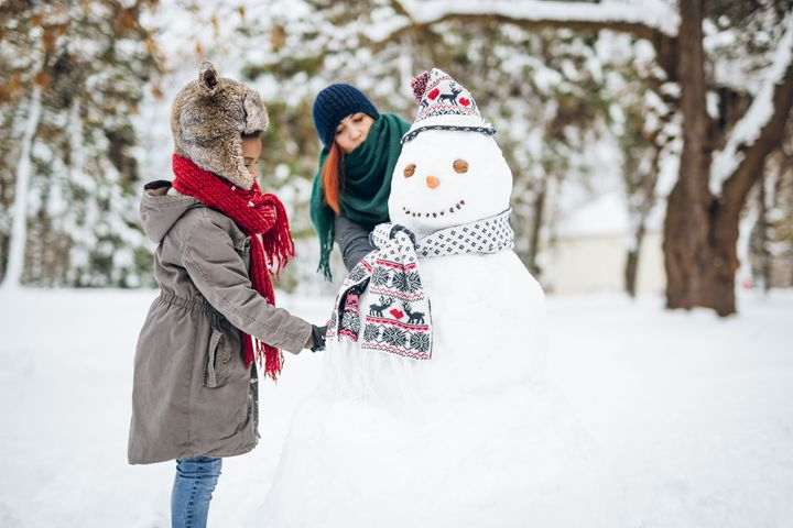 Enjoying winters magics with beloved ones, having fun and making a snowman