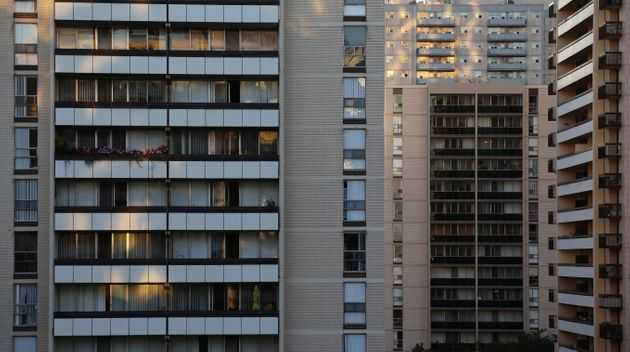 A stock photo shows balconies on high-rise apartment