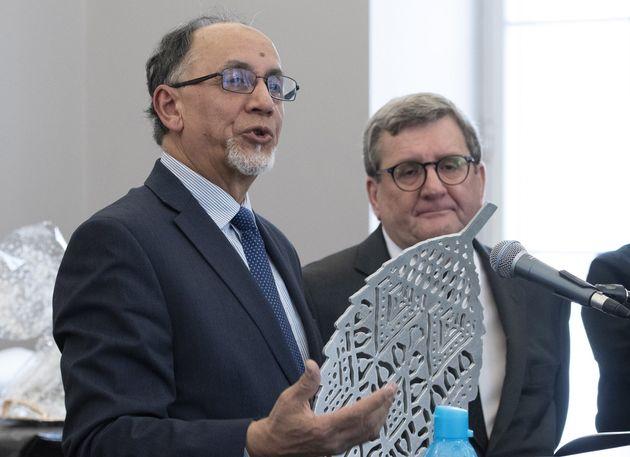 Quebec Islamic cultural centre president Boufeldja Benabdallah, left, and Quebec City mayor Regis Labeaume...