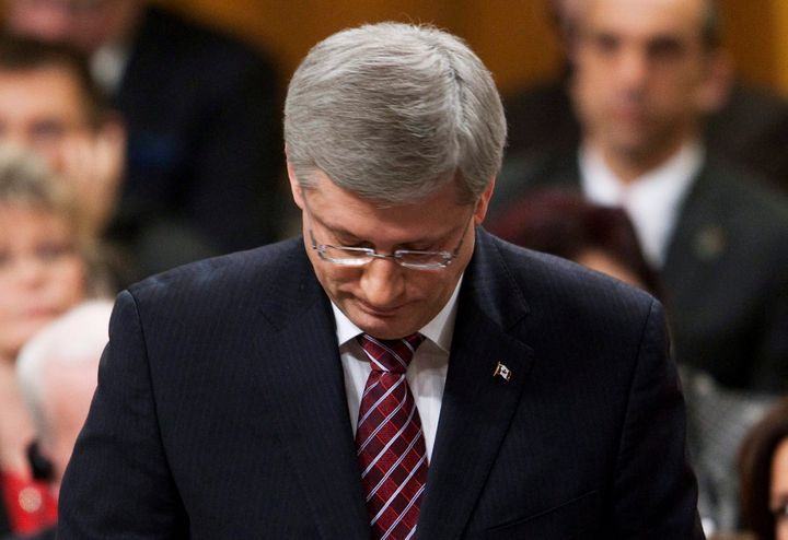 Stephen Harper rises in the House of Commons after his government was defeated on a Liberal contempt of Parliament motion in Ottawa on March 25, 2011.