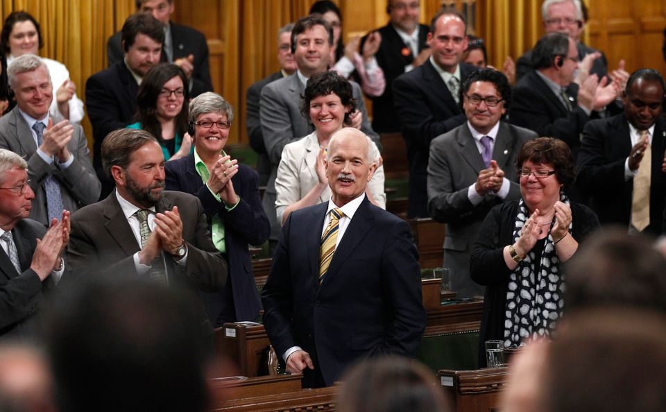 New Democratic Party leader Jack Layton receives a standing ovation while speaking in the House of Commons...