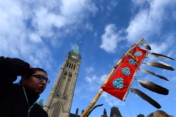 Assembly of First Nations Youth Council member Clayton Tootoosis takes part in an Assembly of First Nations rally on Parliament Hill in Ottawa on Dec. 10, 2013.