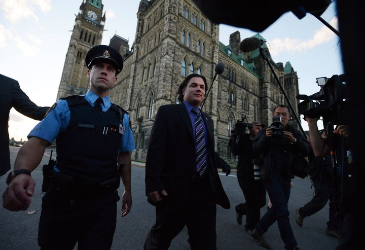 Senator Patrick Brazeau leaves the Senate on Parliament Hill in Ottawa on Wednesday, October 23, 2013.