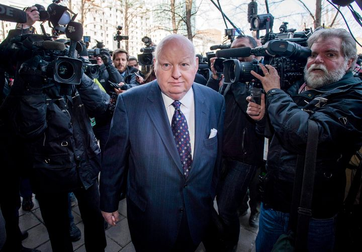 Sen. Mike Duffy arrives for his first court appearance at the courthouse in Ottawa on April 7, 2015.
