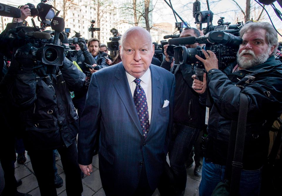 Sen. Mike Duffy arrives for his first court appearance at the courthouse in Ottawa on April 7,
