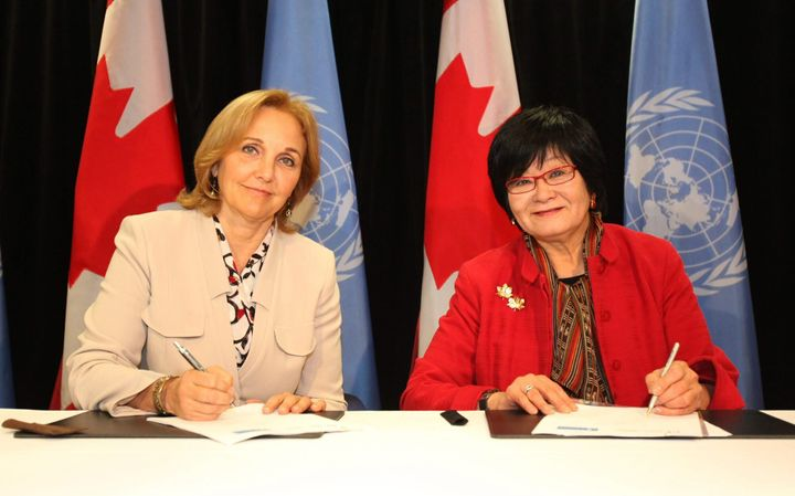 International cooperation minister Beverley Oda (right) and Josette Sheeran (left), executive director of the United Nations World Food Programme, sign a five-year strategic partnership framework in Ottawa on Oct. 25, 2011.