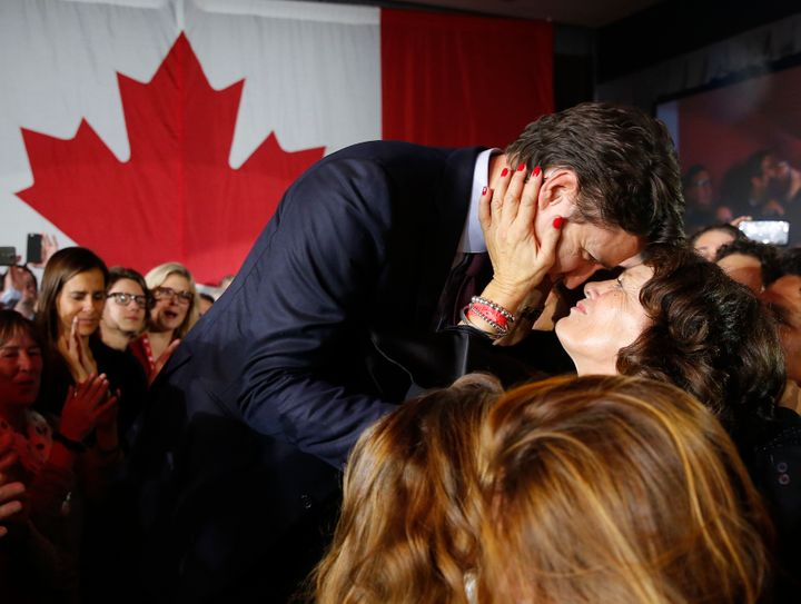 Liberal Leader Justin Trudeau is embraced by his mother Margaret Trudeau as he arrives to give his victory speech after Canada's federal election in Montreal on Oct.19, 2015.