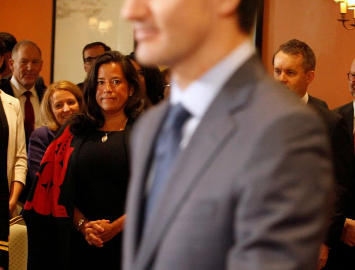 Veterans Affairs Minister Jody Wilson-Raybould watches Prime Minister Justin Trudeau arrive as he shuffles his cabinet after the surprise resignation of Treasury Board President Scott Brison in Ottawa on Jan. 14, 2019.