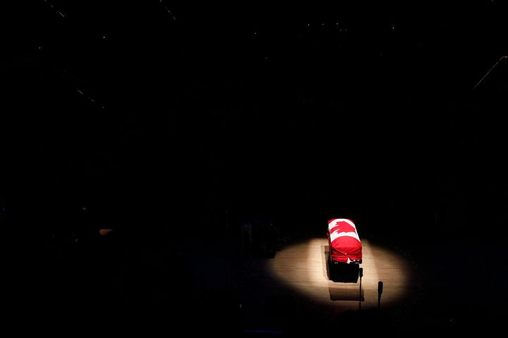 The coffin of the late NDP Leader Jack Layton sits under a spotlight during his state funeral at Roy Thomson Hall in Toronto on Aug. 27, 2011.