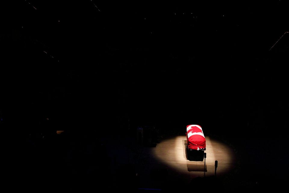 The coffin of the late NDP Leader Jack Layton sits under a spotlight during his state funeral at Roy...