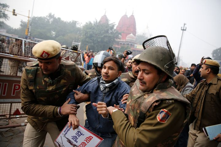 Police detain a protester during a march near the historic Red Fort in New Delhi on Thursday.
