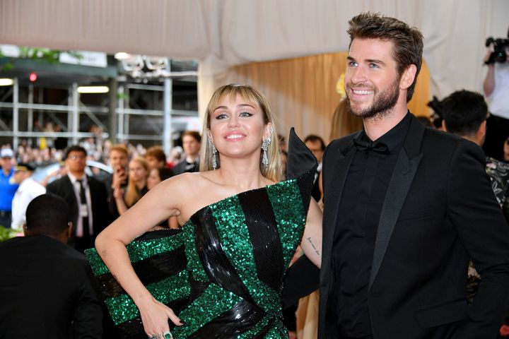 Miley Cyrus and Liam Hemsworth attend the 2019 Met Gala Celebrating Camp: Notes on Fashion at Metropolitan Museum of Art in M