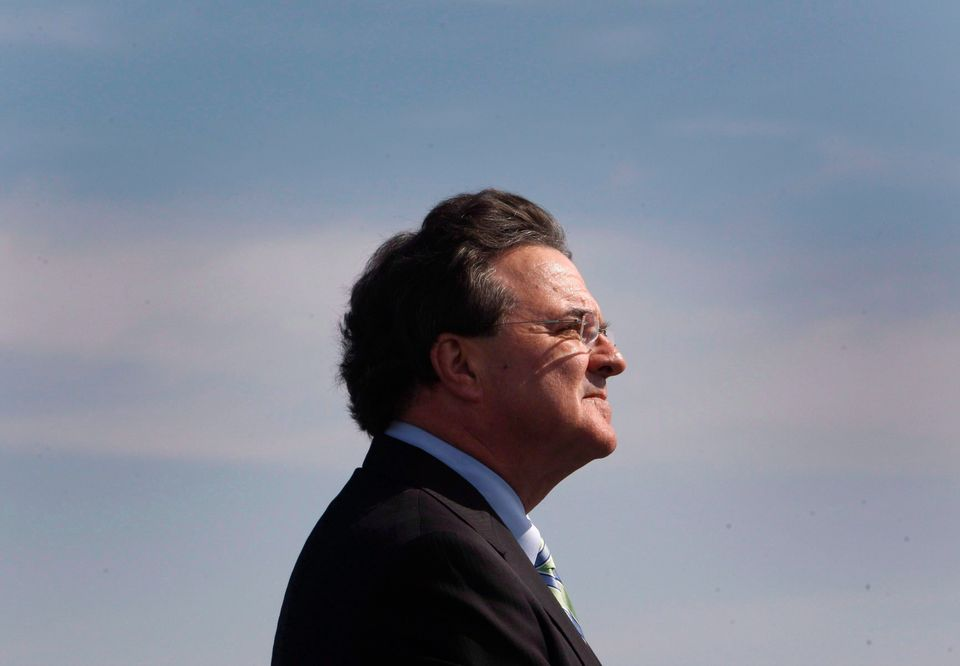 Jim Flaherty speaks to reporters at the Port of Montreal on Sept. 27,