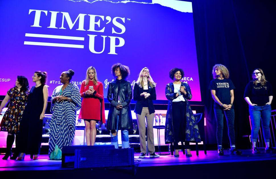 Celebrity News Christy Haubegger, Marisa Tomei, Tarana Burke, Mira Sorvino, Fatima Goss Graves and Amber Tamblyn pose onstage at