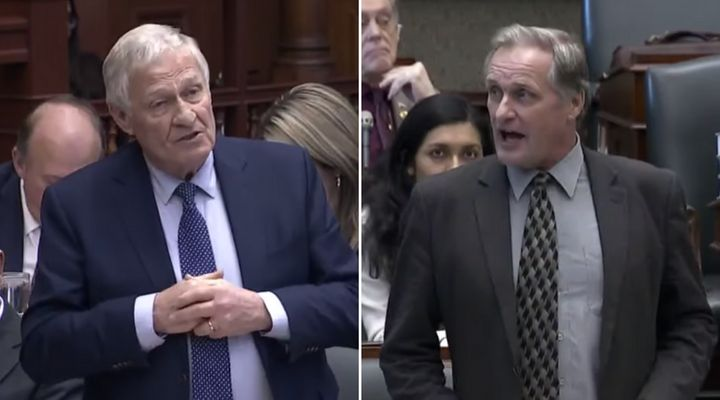 Ontario Minister Ernie Hardeman rises in the legislature to answer a question posed by his nephew, NDP MPP John Vanthof, right, on Dec. 12, 2019.