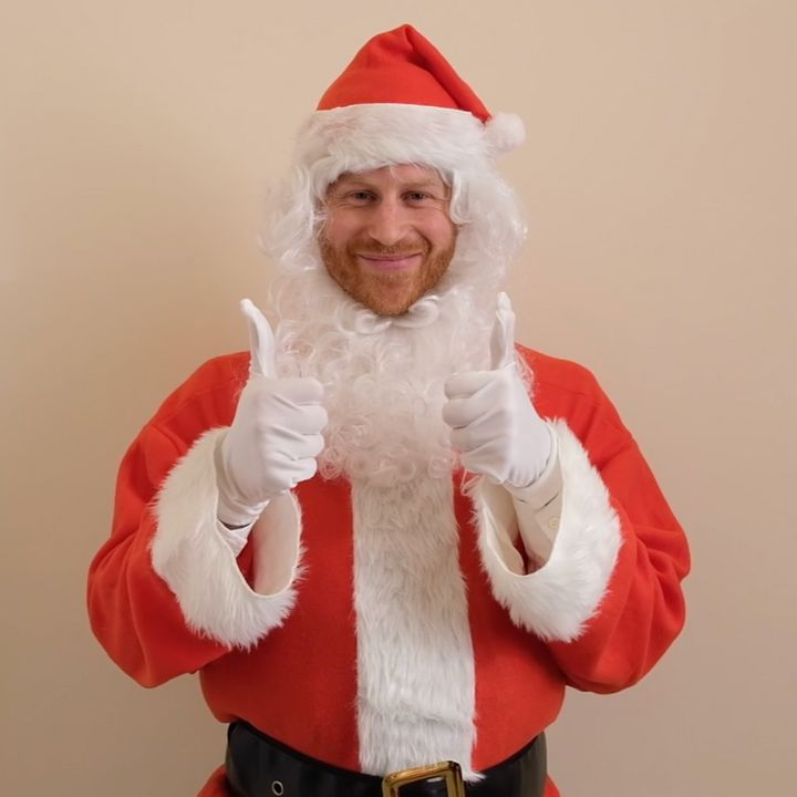 Prince Harry dressed up as Santa Claus, or as some might call him, Father Christmas.