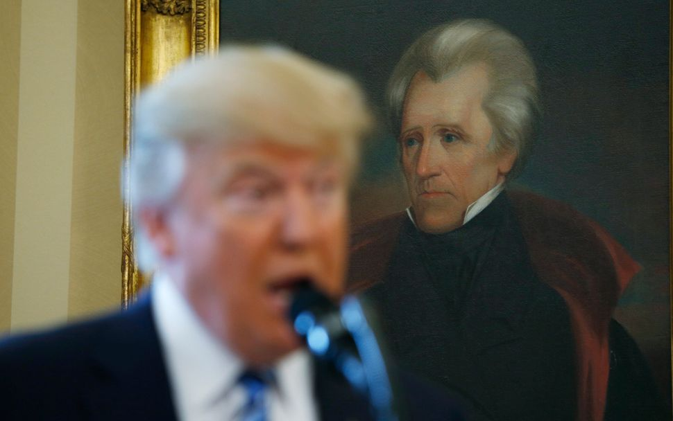President Donald Trump speaks at the White House in front of a portrait of former President Andrew Jackson, who started a cam
