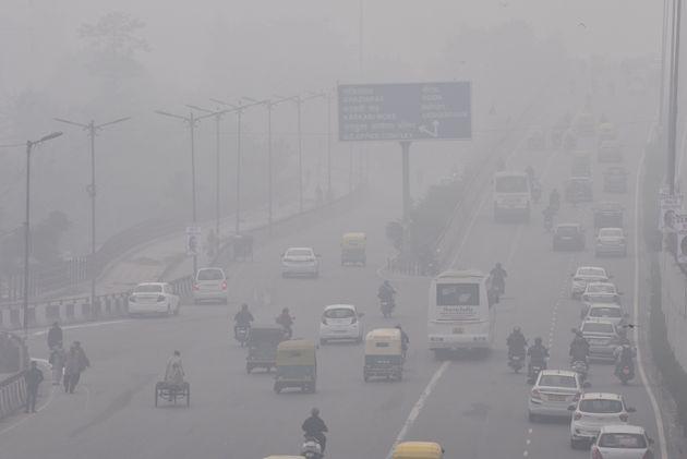 NEW DELHI, INDIA - DECEMBER 20: Traffic is seen amid dense fog, at Geeta colony on December 20, 2019...
