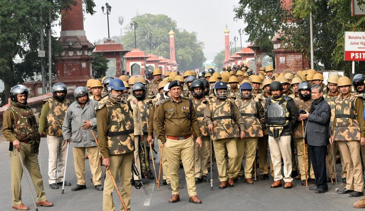 LUCKNOW, INDIA - DECEMBER 20: Police personnel stand guard during anti CAA protest, Old City on December 20, 2019 in Lucknow,