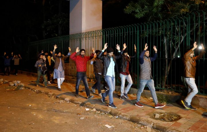 Students raising their hands leave the Jamia Milia University following a protest against a new citizenship law, in New Delhi, India, December 15, 2019. REUTERS/Adnan Abidi