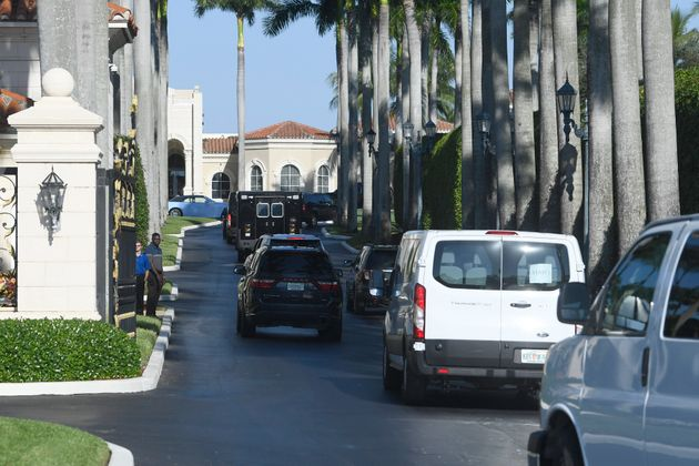 The motorcade with President Donald Trump arrives at his Trump International Golf Club in West Palm Beach,...
