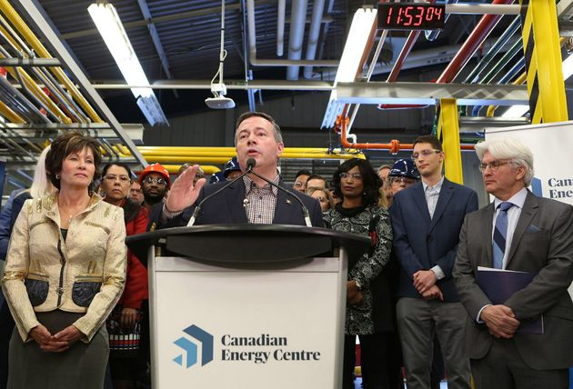 Alberta Premier Jason Kenney, centre, addresses attendees at a press conference to announce the launch...