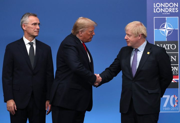 NATO Secretary General Jens Stoltenberg, left, and British Prime Minister Boris Johnson, right, welcome U.S. President Donald
