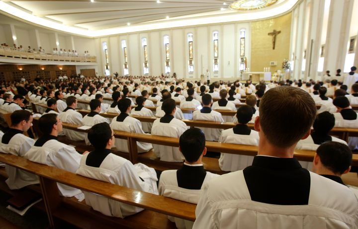 Prelates pray during a mass celebrated by Cardinal Velasio De Paolis in the Legion of Christ main headquarters, the Ateneo Po