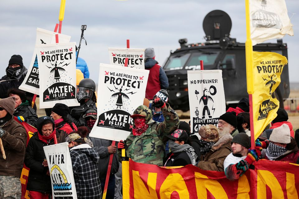 Dakota Access Pipeline protesters square off against police near the Standing Rock Reservation and the...