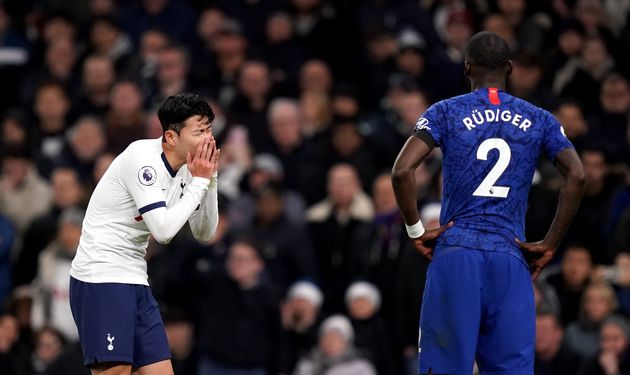 Tottenham Hotspur's Son Heung-min reacts as the VAR reviews a challenge that resulted in a red card for...