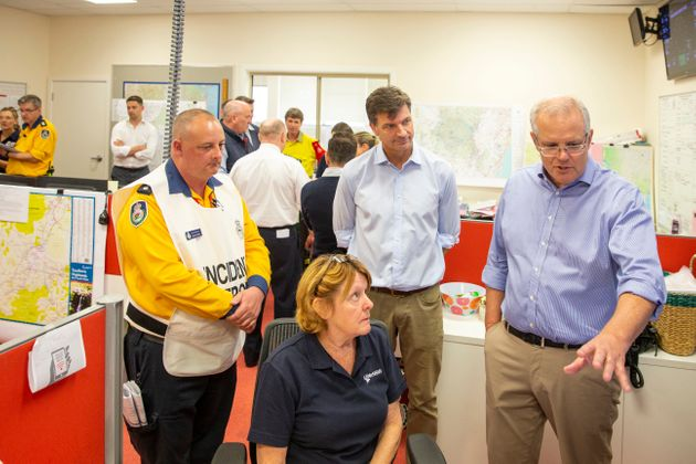Prime Minister Scott Morrison talks to a volunteer at The Picton Evacuation Centre on December 22, 2019...