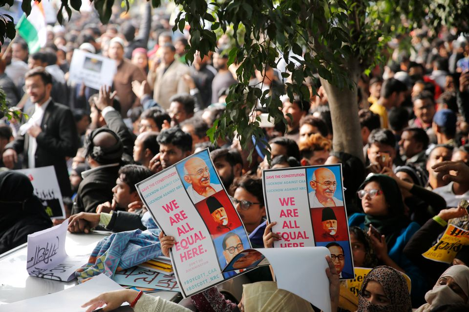 Indians hold placards during protests against India's new citizenship law in Lucknow, India, Thursday,...