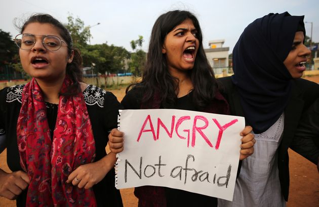 Students shout slogans during a protest against the Citizenship Amendment Act in Bangalore, December...