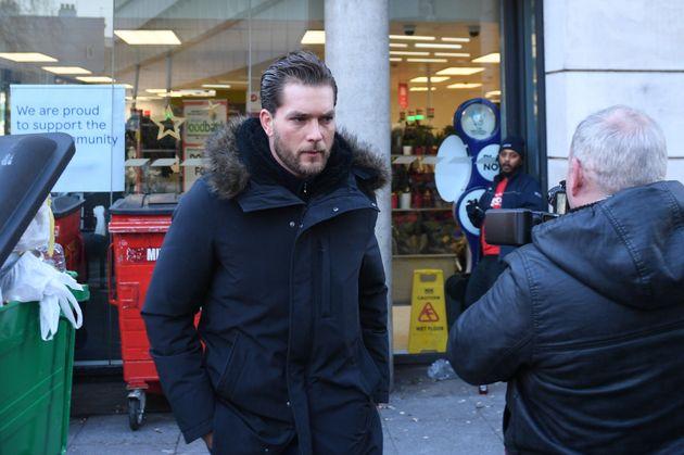 Lewis Burton arrives at Highbury Corner Magistrates' Court, where his girlfriend Caroline Flack is charged...