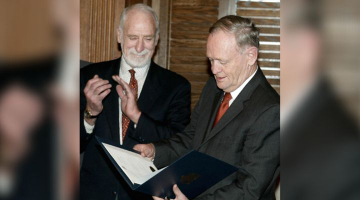 Former prime minister Jean Chrétien looks over the Kyoto Protocol with David Anderson, the federal environment minister at the time, in Ottawa on Dec. 16, 2002.