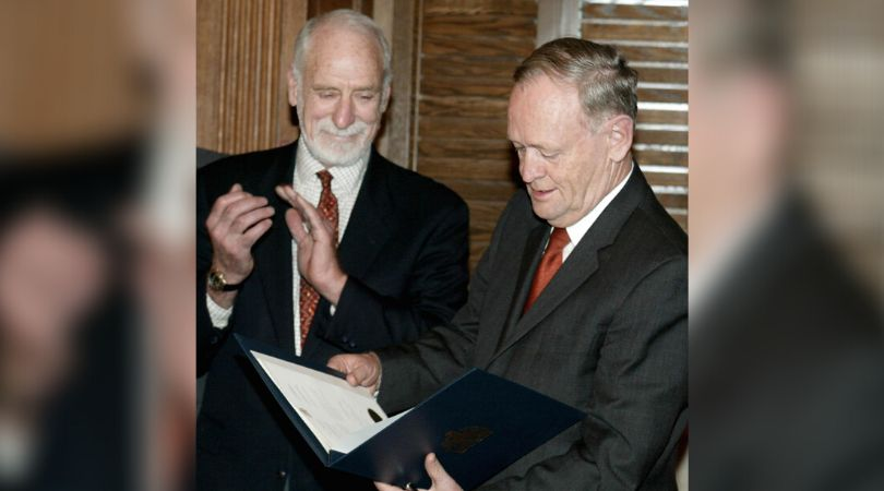 Former prime minister Jean Chrétien looks over the Kyoto Protocol with David Anderson, the federal...