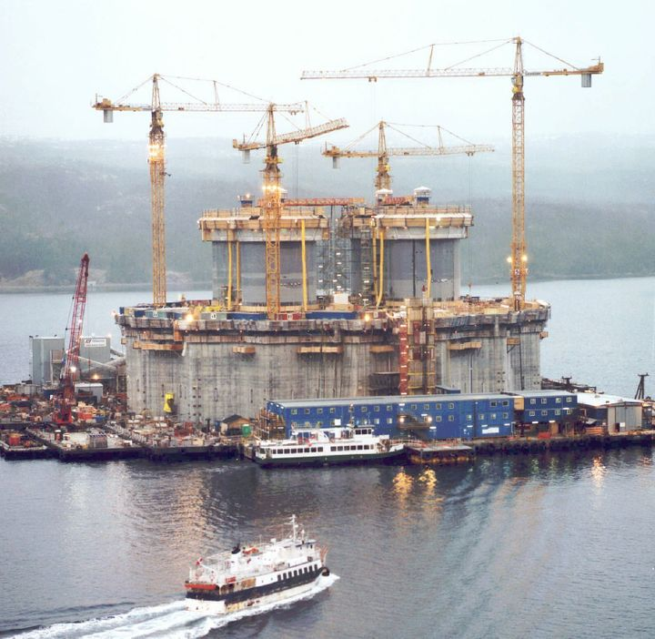 Construction crews are seen here putting the finishing touches on the massive base section of the $4.2-billion Hibernia offshore oil platform in Bull Arm, N.L., in April 1996. The federal government bought a stake in the project in 1993 to help save it from collapse.