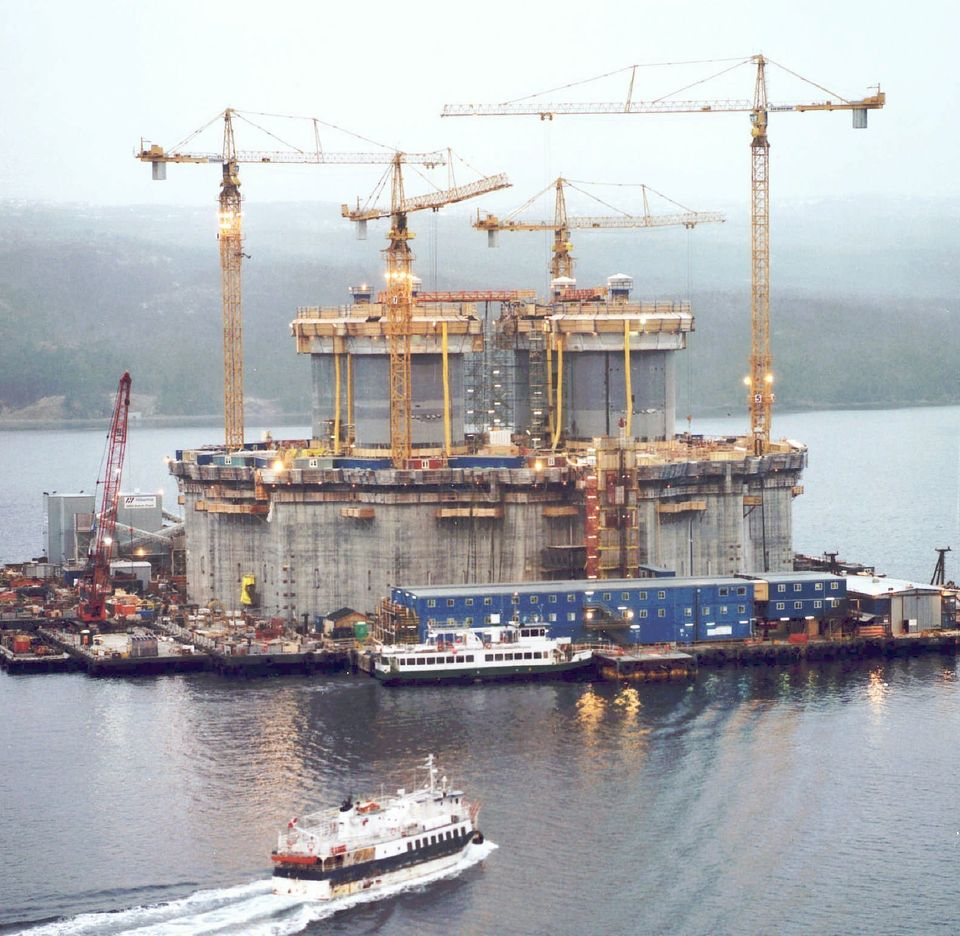 Construction crews are seen here putting the finishing touches on the massive base section of the $4.2-billion...